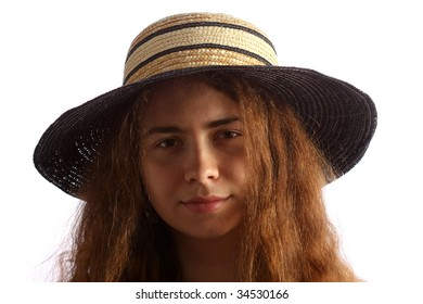Young brunette girl and straw hat, isolated on white