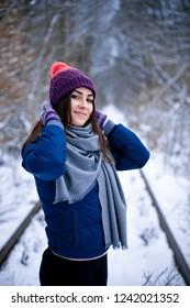 Young Brunette girl walk in winter park