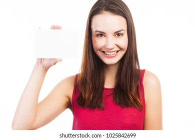 Young brunette showing a blank business card, isolated on white