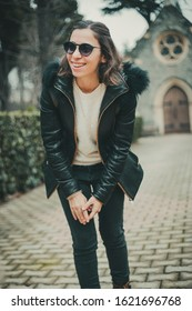 Young Brunette Turkish woman in confident mood and she is smiling