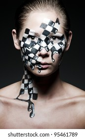 a young brunette wearing a creative chess make up