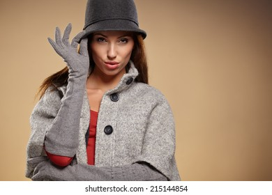 Young brunette woman in autumn color. Studio shoot
