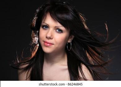 young brunette woman beauty portrait studio shot