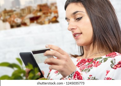 a young brunette woman buying with internet