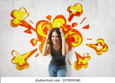 Young brunette woman in casual clothes making brain explosion gesture with cartoon explosion drawn on white wall background. People and objects. Feelings and emotions. Digital art.