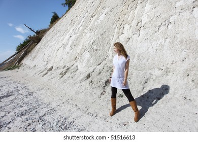 Young brunette woman at the chalk cliffs of ¼gen