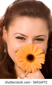 young brunette woman with flower isolated on white