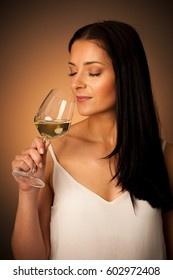 young brunette woman with a glass of white wine