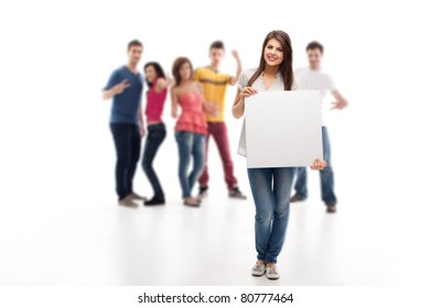 young brunette woman holding blank advertising banner in front of approving people