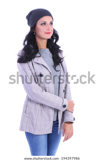 Young brunette woman in jeans and shirt on white