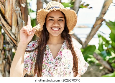Young brunette woman outdoors on a sunny day of summer thinking attitude and sober expression looking self confident