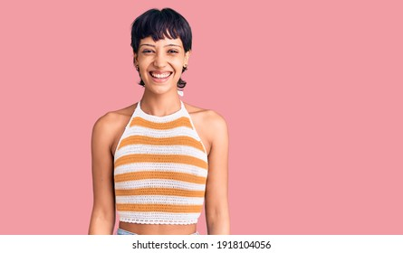 Young brunette woman with short hair wearing casual clothes with a happy and cool smile on face. lucky person.