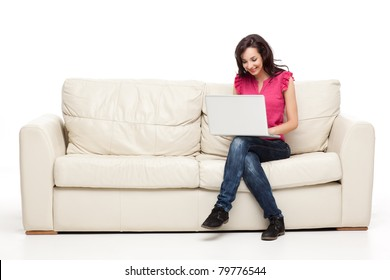 young brunette woman sitting comfortable with laptop on couch