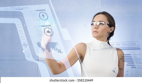 A young brunette woman in a white high-tech dress is wearing smart glasses and pressing her hand up against a holographic screen
