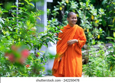 Young Buddhist Monk Smiling At Sunny Day