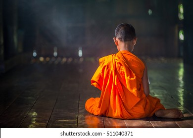 Young Buddhist novice monk reading, Young Buddhist novice monk study inside monastery, Ayutthaya, Thailand.