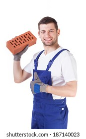 Young builder holding brick in his hand