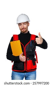 Young builder holding folder and showing thumb up, isolated on a white background