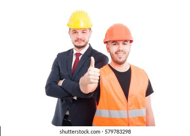 Young builder showing you the thumbs up or ok sign and smiling isolated on white background