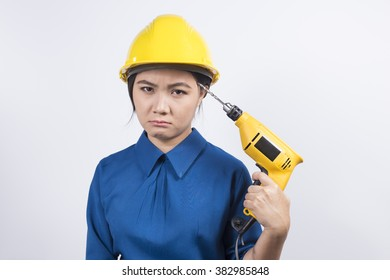 Young builder woman with a drill