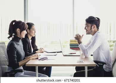 Young Buiness people talking together at office room, people interview concept.