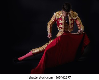 Young bullfighter, dressed in traditional costume to fight