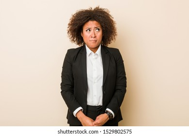 Young business african american woman confused, feels doubtful and unsure.