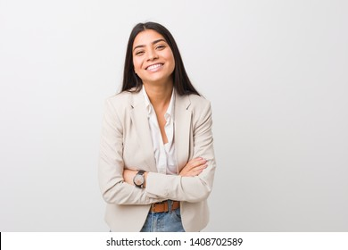 Young business arab woman isolated against a white background laughing and having fun.