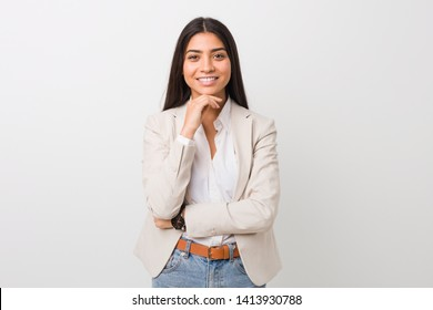 Young business arab woman isolated against a white background smiling happy and confident, touching chin with hand.