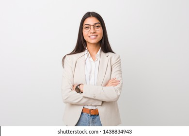 Young business arab woman isolated against a white background who feels confident, crossing arms with determination.