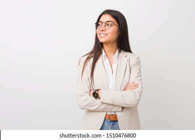 Young business arab woman isolated against a white background smiling confident with crossed arms.