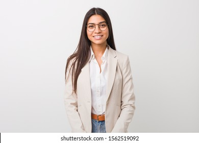 Young business arab woman isolated against a white background happy, smiling and cheerful.