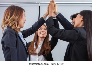 Young business of Asian people standing and  join hand together with white background