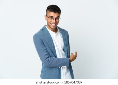 Young business Brazilian man isolated on white background pointing back