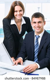 Young business colleagues in the workplace