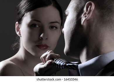 a young business couple on black background