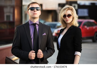 Young business couple on the city street
