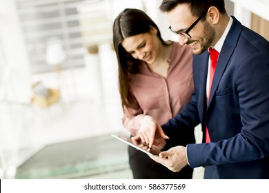 Young business couple with tablet in the office