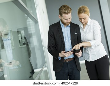 Young business couple using tablet in the office