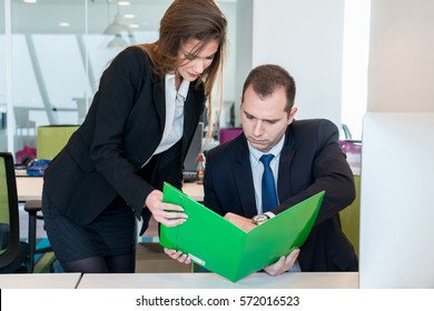 Young business couple working together in the modern office on computer laptop on projects