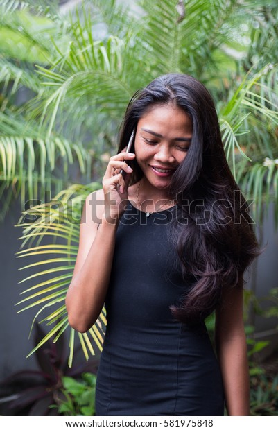Young business girl using a smart phone outdoors