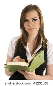 Young business lady writing in a folder. Studio with isolated white background.