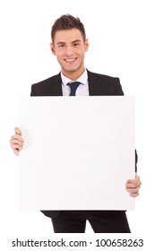 Young business man with blank board isolated on white