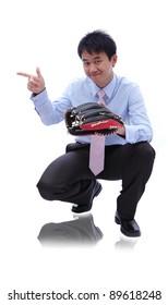 Young Business man catch baseball