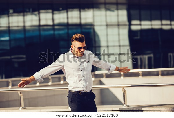 Young business man celebrates freedom success arms. Positive human emotions face expression feelings