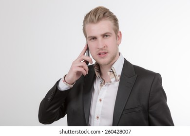 Young business man with cell phone
