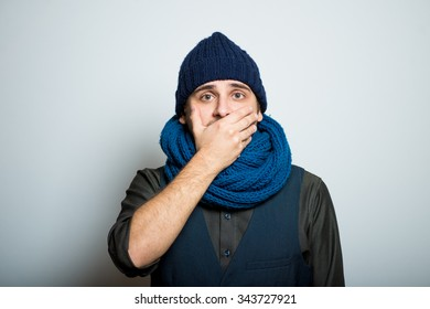 young business man closes a mouth hands winter style clothes, studio shot isolated on the gray background