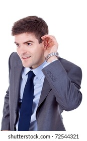 Young business man cupping hand behind ear on white background - cant hear you concept