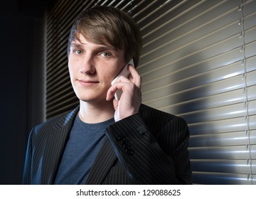 young business man in a dark office