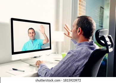 Young business man in front of computer having video conference call with coworker. Waving hand to camera on video call from home office. Friends greeting each other - Shutterstock ID 1815923972